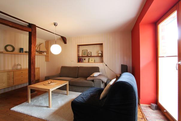Ferienwohnung in Zempin  Wohnzimmer mit Kamin, 5-Sterne-Ferienwohnung
