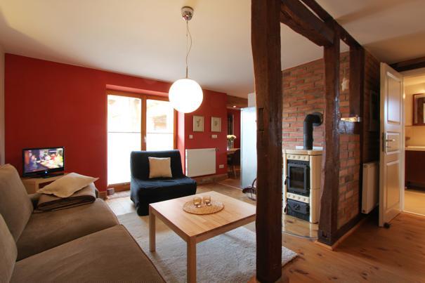 2-Zimmer-Ferienwohnung in Zempin  Wohnzimmer mit Kamin